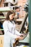 Woman programming process inside factory Stock Image