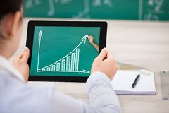 Woman with progress chart on digital tablet Royalty Free Stock Photo