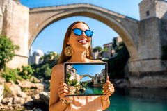 Woman promoting tourism in Mostar city Royalty Free Stock Image