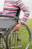 Woman propelling wheelchair Royalty Free Stock Images