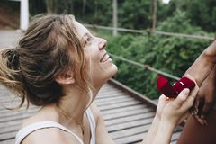 Woman proposing to her happy girlfriend outdoors love and marriage concept Stock Photography