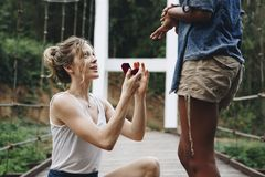 Woman proposing to her happy girlfriend. Outdoors love and marriage concept stock images
