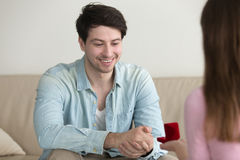 Woman proposing to young man, girlfriend asking boyfriend to mar Royalty Free Stock Image
