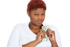 Woman protecting her cash Stock Images