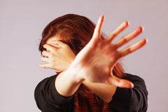 Woman protecting herself Royalty Free Stock Images