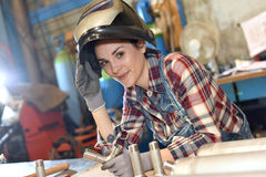 Woman with protection helmet working on metal Royalty Free Stock Image