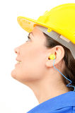 Woman with protective equipment and earplugs Royalty Free Stock Photos