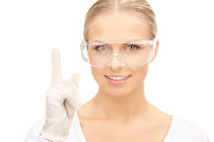 Woman in protective glasses and gloves Royalty Free Stock Image