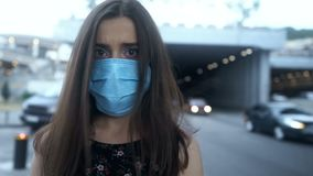 Woman in protective mask in city with polluted air, epidemic, airborne disease. Stock footage stock video