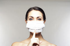 Woman with protective mask saying shh Royalty Free Stock Photos