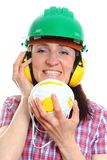 Woman with protective mask wearing helmet and headphones Royalty Free Stock Photos