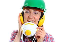 Woman with protective mask wearing helmet and headphones Royalty Free Stock Image