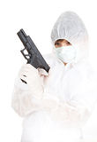 Woman in protective uniform and mask with gun Stock Image