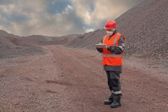 The woman in protective working clothes. labor protection Royalty Free Stock Images