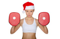 Woman protects herself in Santa Claus hat Stock Images