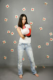 Woman protects love. Woman in red boxing gloves. On a background on a wall stickers with the drawn red hearts Stock Photo