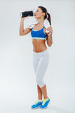 Woman with protein shake bottle on white background Stock Photography