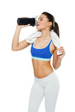 Woman with protein shake bottle on white background Royalty Free Stock Photo