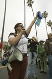 A woman protester with a loud speaker gestures with her arm to the crowd at an anti-Iraq War protest march in Santa Barbara, Calif Stock Photos