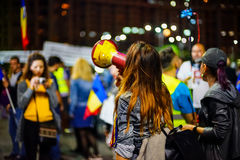 Woman protesting with speaking-tube, Bucharest, Romania Royalty Free Stock Photography