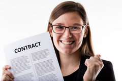 Woman proudly holding her job contract Stock Photography