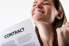 Woman proudly holding her job contract. Woman proudly holding her permanent job contract Stock Photography