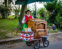 Woman provides entertainment on a calliope in a German park Royalty Free Stock Photos