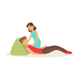 Woman providing first aid to a lying injured man vector Illustration. On a white background Stock Images