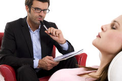 Woman by the psychologist. Woman by the man psychologist royalty free stock image