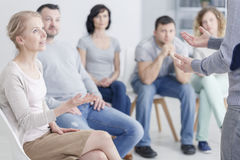 Woman psychologist speaking. During group psychotherapy session royalty free stock photo