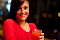 Woman in a pub Stock Photography