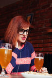 Woman In Pub Using Phone Stock Photography
