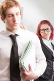 Woman publicly offending a colleague Stock Photography