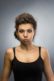 Woman with  puffing out one's cheeks Royalty Free Stock Photos
