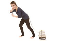 Woman pull books with chain. A woman pulling her stack of books with a chain Stock Photo