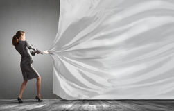 Woman pull curtain royalty free stock images