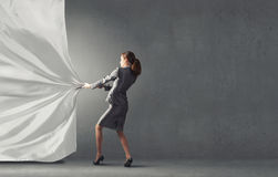 Woman pull curtain Stock Photo