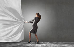 Woman pull curtain Stock Photography