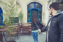 Woman pull man to the restaurant Royalty Free Stock Photo