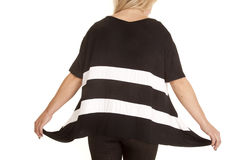 Woman pull out sides shirt Stock Image