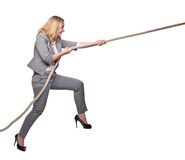 Woman pull the rope Royalty Free Stock Photography