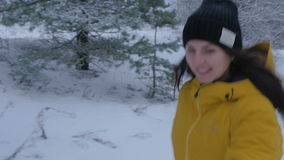 Woman pull a sled with a child in winter Park. Steadicam motion, 4K. The woman, sleigh, winter, game cameras, shooting in duranii, child snow winter 4k stock video