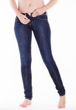 Woman pull up jeans Royalty Free Stock Photos