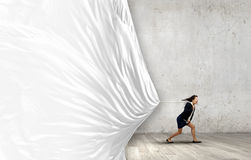 Woman pulling banner Royalty Free Stock Images