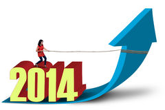 Woman pulling 2014 with chain. Asian woman is pulling 2014 with chain on white background Stock Photo