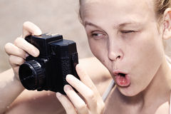 Woman pulling a comical face as she views in the Stock Photography