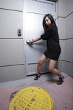 Woman pulling on the door Royalty Free Stock Photography
