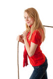 Woman pulling grey rope. Young, long hair, woman pulling grey rope, tug-of-war Royalty Free Stock Photography