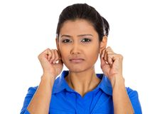 Woman pulling gripping ears sorry for what she did Stock Images