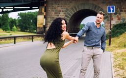 Woman pulling guy`s hand. Follow me - happy young women pulling guy`s hand Royalty Free Stock Images